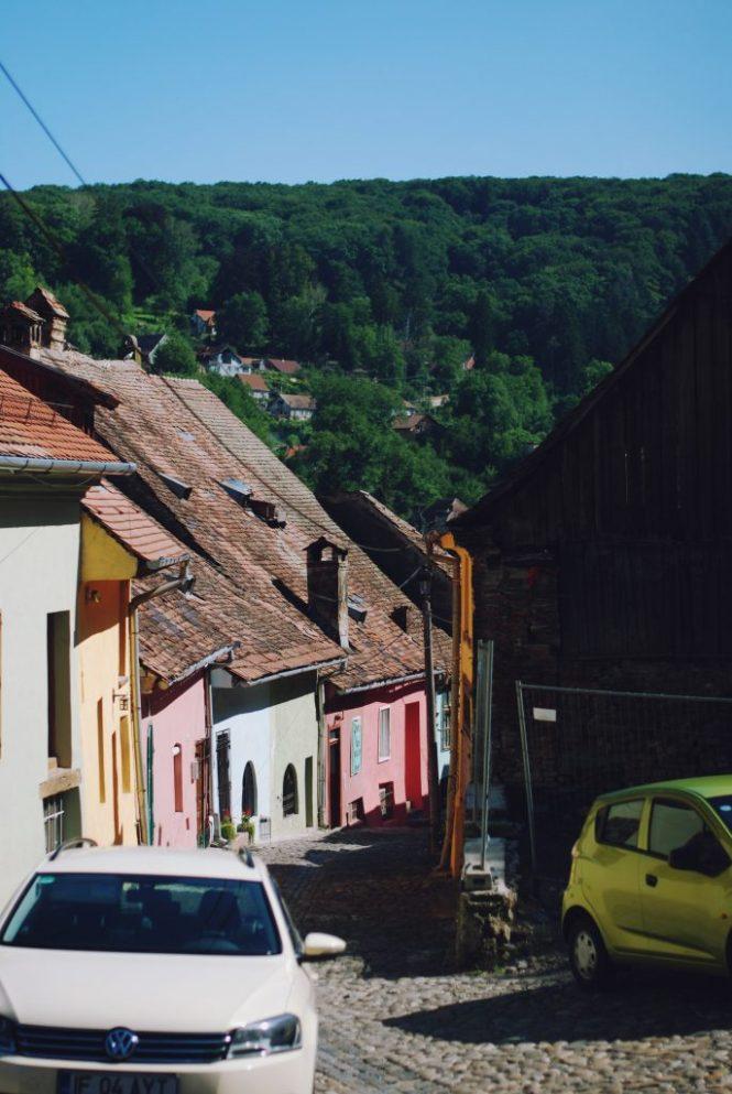 Visit Romania, visit sighisoara, beautiful destinations, travel to Romania, white off shoulder top post, Andreea Birsan