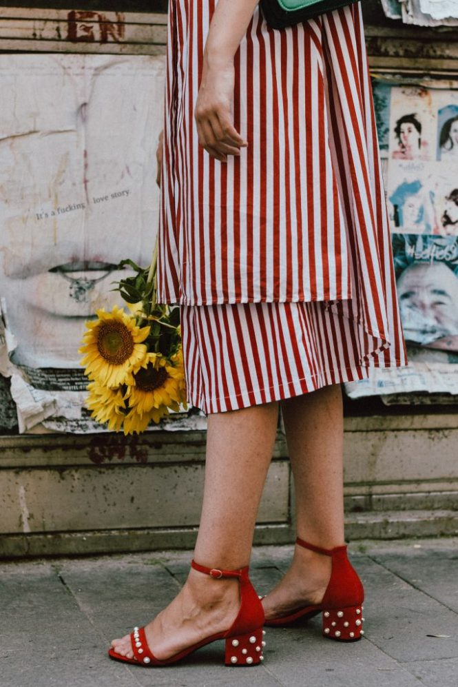 Zara red and white midi striped dress, Asos vertical striped dress, topshop stripe button down shirt dress, retro sleeves dress, puffy sleeves, mango striped red and white midi skirt, urban outfitters circle skirt, red velvet pearl embellished sandals, shoes with pearls, the pearls trend on shoes, red oval kurt cobain sunglasses, nirvana red sunglasses, green suede gucci dyonisus bag lookalike, emerald green shoulder bag, where to find the best alternative to the expensive gucci bags, gucci dyonisus dupe bag, straw boater hat, andreea birsan, couturezilla, cute summer outfit ideas 2017, statement earrings, sunflowers bouquet, how to wear all red like a pro, all red summer outfit, the best way to layering in summer, the easy way to layer in summer, how to wear a dress over a skirt, tips on wearing a dress over a skirt, summer layering, sunflower bouquet, the shoes that are all over instagram, the zara sold out dress, where to find this zara dress, how to wear red and green together, red and green outfit, all red summer outfit for women, how to rock an all red outfit, modern retro outfit, urban vibe, how to look Parisian chic, European summer street style inspiration for women 2017, pinterest chic outfit ideas for woman, summer outfit ideas, summer ootd inspiration, outfit of the day, ootd, fashion icon, style inspiration, fashionista, fashion inspiration, style inspo, what to wear in summer, how to look French, chic on a budget, zara outfit, mango, topshop, asos, river island, forever 21, urban outfitters, how to mix high end pieces with luxury ones, zara and Gucci, how to look chic when not wearing a dress, outfit alternatives for summer, tomboy chic, minimal outfit, tumblr girls photos, pictures, happy girl, women, smart casual outfits, the best outfit ideas 2017, what to wear when you don't feel inspired, summer in Europe, weekend attire, uniform, French women in summer, European outfit ideas 2017, minimal chic outfit, how to stand out, the best outfit ideas for s