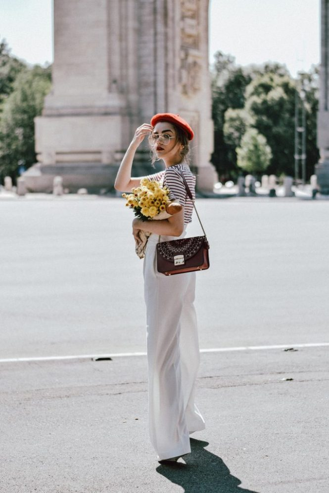 White wide leg pants zara, mango stripe t-shirt, urban outfitters striped tee, asos red beret, forever21 white lace up corset, furla red bag, furla ruby red lace trim metropolis shoulder bag, furla metropolis in red, ray ban aviator clear lens glasses, gucci ace heart embroidered sneakers, andreea birsan, couturezilla, cute summer outfit inspiration, how to look Parisian chic, European summer street style inspiration for women 2017, pinterest chic outfit ideas for woman, summer outfit ideas, summer ootd inspiration, outfit of the day, ootd, fashion icon, style inspiration, fashionista, fashion inspiration, style inspo, what to wear in summer, how to look French, chic on a budget, zara outfit, mango, topshop, asos, river island, forever 21, urban outfitters, how to mix high end pieces with luxury ones, zara and Gucci, how to look chic when not wearing a dress, outfit alternatives for summer, tomboy chic, minimal outfit, tumblr girls photos, pictures, happy girl, women, smart casual outfits, the best outfit ideas 2017, what to wear when you don't feel inspired, summer in Europe, weekend attire, uniform, French women in summer, European outfit ideas 2017, minimal chic outfit, how to stand out, the best outfit ideas for summer, the sunglasses you have seen everywhere on Instagram, glasses, uk fashion blogger, united kingdom, uk fashion blog, fashion and travel blog, Europe, women with style, street style, summer fashion trends 2017, silver hoop earrings, low bun, classy bun, red lipstick, fresh flowers, how to wear palazzo trousers, palazzo pants, wide leg trousers, how to make wide leg trousers look even chicer, parisian chic, red and white summer outfit 2017