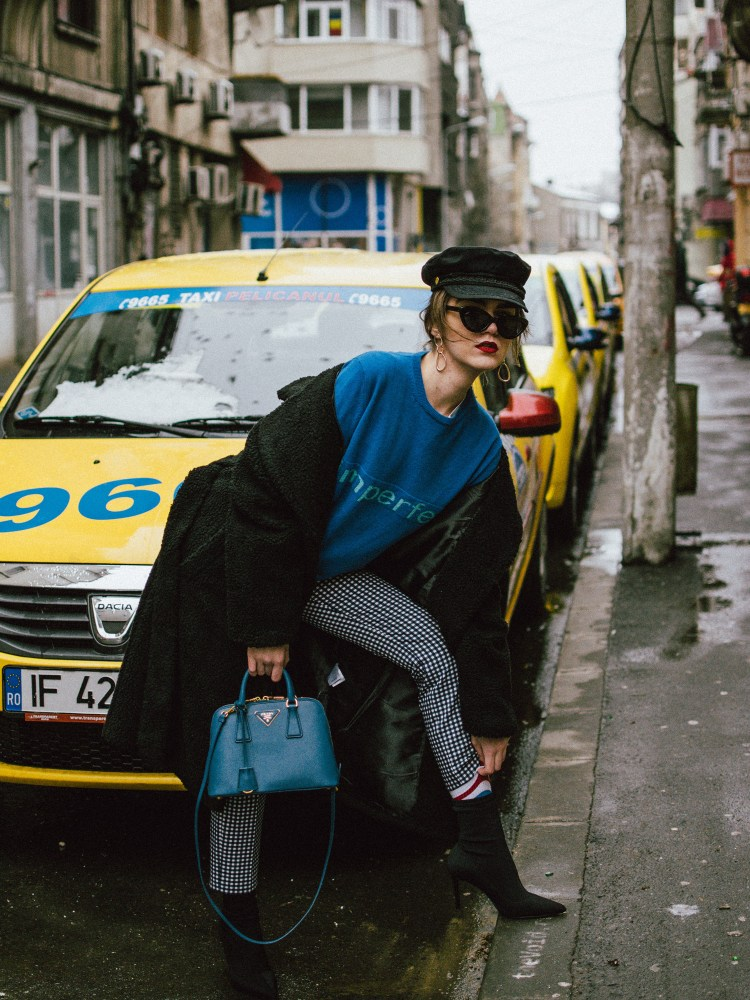 Zara high waisted gingham trousers, high waist pants, vichy print pants, blue cashmere sweater with graphic message, white oversized tee, boyfriend white t-shirt, black baker boy hat, newsboy cap, trending instagram cap, prada saffiano lux bolsa a mano cobalt blue bag, prada mini blue bag, ladylike bag, black heeled sock boots, balenciaga lookalike boots, long line teddy bear coat, warm coat for winter, the best coats for this winter, cat eye sunglasses, minimal earrings in gold, low bun, andreea birsan, couturezilla, cute winter outfit ideas for 2018 and 2017, what to wear to work in 2018, what to wear to the office, how to wear gingham in winter, how to look Parisian chic, European summer street style inspiration for women 2017, pinterest chic outfit ideas for woman, summer outfit ideas, summer ootd inspiration, outfit of the day, ootd, fashion icon, style inspiration, fashionista, fashion inspiration, style inspo, what to wear in summer, how to look French, chic on a budget, zara outfit, mango, topshop, asos, river island, forever 21, urban outfitters, how to mix high end pieces with luxury ones, zara and Gucci,outfit alternatives for summer, tomboy chic, minimal outfit, tumblr girls photos, pictures, happy girl, women, smart casual outfits, the best outfit ideas 2017, what to wear when you don't feel inspired, summer in Europe, weekend attire, uniform, French women in summer, European outfit ideas 2017, minimal chic outfit, how to stand out, the best outfit ideas for summer, the sunglasses you have seen everywhere on Instagram, glasses, uk fashion blogger, united kingdom, uk fashion blog, fashion and travel blog, Europe, women with style, street style, summer fashion trends 2017, best fashion ideas, styling, fall fashion, fall outfit, fall ootd, fall perfect, transitional dressing, best transitional outfit ideas, how to wear statement earrings, dressing for autumn, autumn outfit, winter outfit ideas for work and school 2017