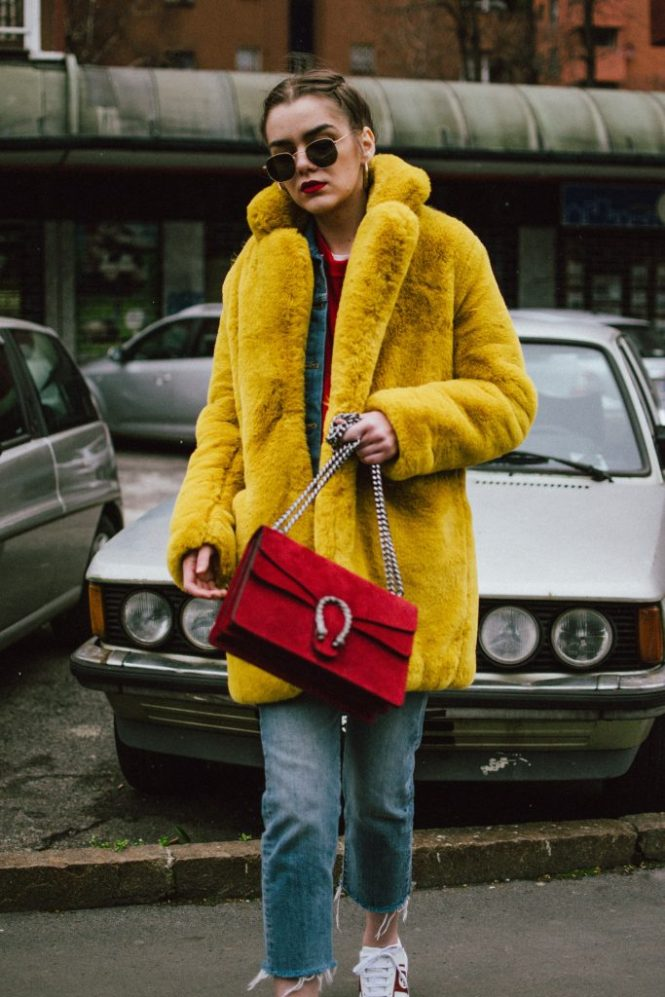 Boohoo yellow faux fur coat, double denim levi's jeans, gucci sneakers, gucci bag, milan, cute winter outfit 2018, andreea birsan, couturezilla, cropped raw hem levi's jeans, raw hem star printed cropped denim jacket, red cashmere sweater, t-shirt, ray ban hexagonal sunglasses, gucci red suede dionysus bag, gucci white and red sneakers, how to wear sneakers in winter, how to wear double denim like a pro, colorful coat, teddy bear coat in yellow, corn braids, heart shaped earrings, how to dress in winter, how to layer like a fashion blogger, yellow red and blue outfit, best gucci sneakers, how to look Parisian chic, European summer street style inspiration for women 2017, pinterest chic outfit ideas for woman, summer outfit ideas, summer ootd inspiration, outfit of the day, ootd, fashion icon, style inspiration, fashionista, fashion inspiration, style inspo, what to wear in summer, how to look French, chic on a budget, zara outfit, mango, topshop, asos, river island, forever 21, urban outfitters, how to mix high end pieces with luxury ones, zara and Gucci,outfit alternatives for summer, tomboy chic, minimal outfit, tumblr girls photos, pictures, happy girl, women, smart casual outfits, the best outfit ideas 2017, what to wear when you don't feel inspired, summer in Europe, weekend attire, uniform, French women in summer, European outfit ideas 2017, minimal chic outfit, how to stand out, the best outfit ideas for summer, the sunglasses you have seen everywhere on Instagram, glasses, uk fashion blogger, united kingdom, uk fashion blog, fashion and travel blog, Europe, women with style, street style, summer fashion trends 2017, best fashion ideas, styling, fall fashion, fall outfit, fall ootd, fall perfect, transitional dressing, best transitional outfit ideas, how to wear statement earrings, dressing for autumn, autumn outfit, winter outfit ideas for work and school 2017