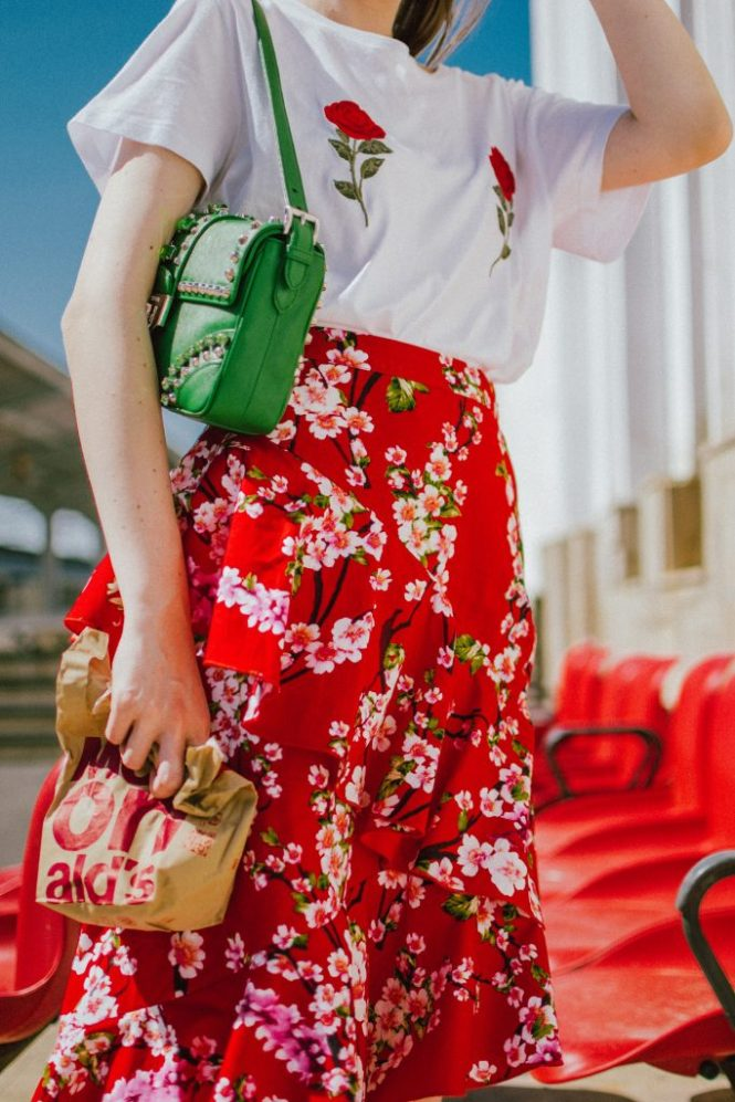NA-KD asymmetric floral print skirt, rose patch t-shirt, gucci heart sneakers, prada green bag, andreea birsan, couturezilla, cute spring outfit ideas 2018, cherry blossom skirt, midi skirt with double frills, red midi skirt with double frill and floral print, sakura print midi skirt, feminine skirt, how to temper a feminine look, rose patch white t-shirt from nakd, the popular rose boobs t-shirt, how to mix floral prints, gucci ace heart embroidered white sneakers, red midi skirt, red and white outfit, gucci sneakers, gucci leather sneakers, white trainers, how to wear a skirt with sneakers, green prada bag with studs and stones, green shoulder bag, h&m oval sunglasses, oval sunglasses, micro sunglasses trend, how to wear a midi skirt, what shoes to wear with a midi skirt, how to wear an asymmetric skirt, asymmetrical skirt, sakura, floral print midi skirt, flower print, red, red skirt, what color to wear with red, red and green, gold hoop earrings, skirt and sneakers, how to look Parisian chic, European summer street style inspiration for women 2017, pinterest chic outfit ideas for woman, summer outfit ideas, summer ootd inspiration, outfit of the day, ootd, fashion icon, style inspiration, fashionista, fashion inspiration, style inspo, what to wear in summer, how to look French, chic on a budget, zara outfit, mango, topshop, asos, river island, forever 21, urban outfitters, how to mix high end pieces with luxury ones, zara and Gucci,outfit alternatives for summer, tomboy chic, minimal outfit, tumblr girls photos, pictures, happy girl, women, smart casual outfits, the best outfit ideas 2017, what to wear when you don't feel inspired, summer in Europe, weekend attire, uniform, French women in summer, European outfit ideas 2017, minimal chic outfit, how to stand out, the best outfit ideas for summer, the sunglasses you have seen everywhere on Instagram, glasses, uk fashion blogger, united kingdom, uk fashion blog, fashion and travel blog, Europe, women with style, street style, summer fashion trends 2017, best fashion ideas, styling, fall fashion, fall outfit, fall ootd, fall perfect, transitional dressing, best transitional outfit ideas, how to wear statement earrings, dressing for autumn, autumn outfit, winter outfit ideas for work and school 2017