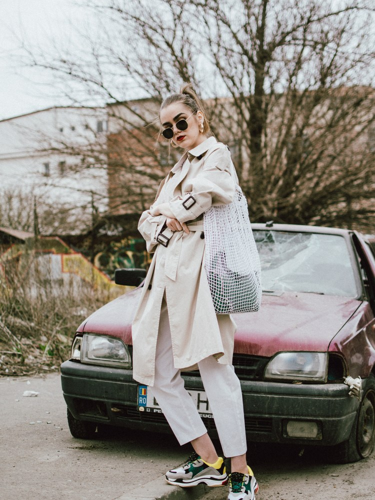 Mango classic beige trench coat, zara white trousers, peg trousers, high waist pants, high waisted trousers in white, belt detail trousers, the popular gucci logo t-shirt, balenciaga inspired triple s sneakers, green saffiano leather prada shoulder bag with studs and stones, green leather prada bag, statement bag, crochet bag, handmade bag, the bag in bang trend, andreea birsan, couturezilla, cute spring outfit ideas 2018, balenciaga inspired sneakers, balenciaga triple s dupe sneakers, where to find the best alternative to the sold out popular balenciaga sneakers, the ugly sneakers trend, all white outfit for spring, how to wear a trench coat, sporty outfit ideas, off duty look, heaxagonal sunglasses, gold hoop earrings, white and beige outfit, classic outfit ideas with a twist, how to wear sneakers and still look cool, how to look Parisian chic, European summer street style inspiration for women 2017, pinterest chic outfit ideas for woman, summer outfit ideas, summer ootd inspiration, outfit of the day, ootd, fashion icon, style inspiration, fashionista, fashion inspiration, style inspo, what to wear in summer, how to look French, chic on a budget, zara outfit, mango, topshop, asos, river island, forever 21, urban outfitters, how to mix high end pieces with luxury ones, zara and Gucci,outfit alternatives for summer, tomboy chic, minimal outfit, tumblr girls photos, pictures, happy girl, women, smart casual outfits, the best outfit ideas 2017, what to wear when you don't feel inspired, summer in Europe, weekend attire, uniform, French women in summer, European outfit ideas 2017, minimal chic outfit, how to stand out, the best outfit ideas for summer, the sunglasses you have seen everywhere on Instagram, glasses, uk fashion blogger, united kingdom, uk fashion blog, fashion and travel blog, Europe, women with style, street style, summer fashion trends 2017, best fashion ideas, styling, fall fashion, fall outfit, fall ootd, fall perfect, transitional dressing, best transitional outfit ideas, how to wear statement earrings, dressing for autumn, autumn outfit, winter outfit ideas for work and school 2017