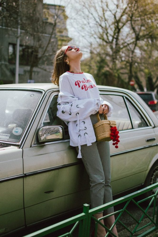 Spring basics, Zara gingham trousers, graphit tee, oversize white jacket with lace up, red shoes, straw bag, andreea birsan, couturezilla, cute spring outfit ideas 2018, high waist check trousers, checkered pants, vichy trousers, black and white trousers, check printed trousers, retro pants, printed t-shirt with message, red cat eye sunglasses, layered gold necklaces, gold hoop earrings, straw bag, raffia bag, the cutest bag for spring and summer, the straw bag trend, where to find the best straw bat, straw bag with red pom pom, red pompom, red accessories, black white and red spring outfit ideas, rattan bag, wicker bag, basket bag for spring and summer, white denim jacket, oversized jacket, oversize white denim jacket with lace out details, denim jacket with a twist, red leather shoes with fun heel, block heel red shoes, red leather, how to look Parisian chic, European summer street style inspiration for women 2017, pinterest chic outfit ideas for woman, summer outfit ideas, summer ootd inspiration, outfit of the day, ootd, fashion icon, style inspiration, fashionista, fashion inspiration, style inspo, what to wear in summer, how to look French, chic on a budget, zara outfit, mango, topshop, asos, river island, forever 21, urban outfitters, how to mix high end pieces with luxury ones, zara and Gucci,outfit alternatives for summer, tomboy chic, minimal outfit, tumblr girls photos, pictures, happy girl, women, smart casual outfits, the best outfit ideas 2017, what to wear when you don't feel inspired, summer in Europe, weekend attire, uniform, French women in summer, European outfit ideas 2017, minimal chic outfit, how to stand out, the best outfit ideas for summer, the sunglasses you have seen everywhere on Instagram, glasses, uk fashion blogger, united kingdom, uk fashion blog, fashion and travel blog, Europe, women with style, street style, summer fashion trends 2017, best fashion ideas, styling, fall fashion, fall outfit, fall ootd, fall perfect, transitional dre