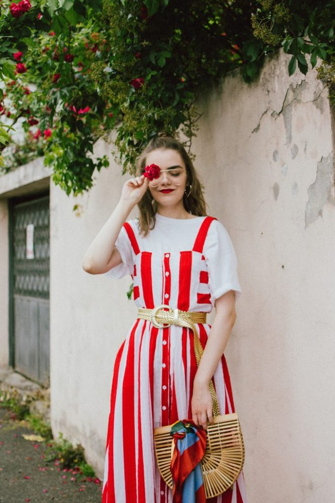 Midi striped dress, white t-shirt, red slingback shoes, cult gaia bag, andreea birsan, couturezilla, cute summer outfit ideas 2018, boohoo red and white striped midi dress, stripe, stripes dress, the perfect summer bag, cult gaia bag, cult gaia lookalike bag, the popular cult gaia bag you have seen all over instagram, zara clear lens aviator glasses, h&m suede kitten heel sling back shoes, red slingback shoes, slingbacks, cotton white t-shirt, white tee, basic white tee, how to layer a dress, dress over tshirt, summer layers, how to layer in summer, roses, heart shaped earrings, bamboo bag, basket bag, raffia bag, handmade bag, woven bag, wicker bag, the perfect summer dress, what to wear when it's hot, how to look Parisian chic, European summer street style inspiration for women 2017, pinterest chic outfit ideas for woman, summer outfit ideas, summer ootd inspiration, outfit of the day, ootd, fashion icon, style inspiration, fashionista, fashion inspiration, style inspo, what to wear in summer, how to look French, chic on a budget, zara outfit, mango, topshop, asos, river island, forever 21, urban outfitters, how to mix high end pieces with luxury ones, zara and Gucci,outfit alternatives for summer, tomboy chic, minimal outfit, tumblr girls photos, pictures, happy girl, women, smart casual outfits, the best outfit ideas 2017, what to wear when you don't feel inspired, summer in Europe, weekend attire, uniform, French women in summer, European outfit ideas 2017, minimal chic outfit, how to stand out, the best outfit ideas for summer, the sunglasses you have seen everywhere on Instagram, glasses, uk fashion blogger, united kingdom, uk fashion blog, fashion and travel blog, Europe, women with style, street style, summer fashion trends 2017, best fashion ideas, styling, fall fashion, fall outfit, fall ootd, fall perfect, transitional dressing, best transitional outfit ideas, how to wear statement earrings, dressing for autumn, autumn outfit, winter outfit ideas for work and school 2017