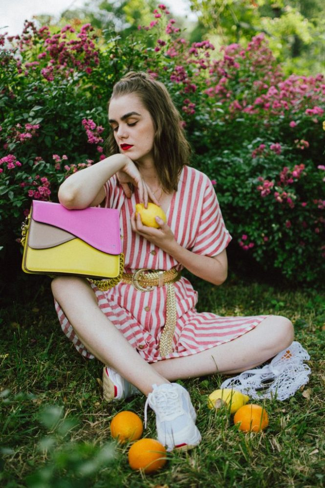 Striped midi dress, chunky white sneakers, statement colorblock shoulder bag, rose garden, coin necklace, andreea birsan, couturezilla, cute summer outfit ideas 2018, coin necklace, mango midi striped linen dress, linen dress, striped midi dress and sneakers, chunky trainers, chunky sneakers, dad sneakers trend, the ugly sneakers trend, white trainers, trainers and feminine dress, retro dress and chunky trainers, gold plated coin necklace, onecklace jewelry, isla fontaine statement shoulder bag, pink and yellow bag, the best bags from isla fontaine, mini bun hairstyle, gold metallic belt, rose garden, the necklace you need to wear this summer, red and white midi dress, crisp white sneakers, balenciaga inspired triple s sneakers, balenciaga dupe sneakers, where to find the budget alternative to the balenciaga triple s sneakers, balenciaga sneakers, trending, summer trends of 2018, how to look Parisian chic, European summer street style inspiration for women 2017, pinterest chic outfit ideas for woman, summer outfit ideas, summer ootd inspiration, outfit of the day, ootd, fashion icon, style inspiration, fashionista, fashion inspiration, style inspo, what to wear in summer, how to look French, chic on a budget, zara outfit, mango, topshop, asos, river island, forever 21, urban outfitters, how to mix high end pieces with luxury ones, zara and Gucci,outfit alternatives for summer, tomboy chic, minimal outfit, tumblr girls photos, pictures, happy girl, women, smart casual outfits, the best outfit ideas 2017, what to wear when you don't feel inspired, summer in Europe, weekend attire, uniform, French women in summer, European outfit ideas 2017, minimal chic outfit, how to stand out, the best outfit ideas for summer, the sunglasses you have seen everywhere on Instagram, glasses, uk fashion blogger, united kingdom, uk fashion blog, fashion and travel blog, Europe, women with style, street style, summer fashion trends 2017, best fashion ideas, styling, fall fashion, fall outfit, fall ootd, fall perfect, transitional dressing, best transitional outfit ideas, how to wear statement earrings, dressing for autumn, autumn outfit, winter outfit ideas for work and school 2017