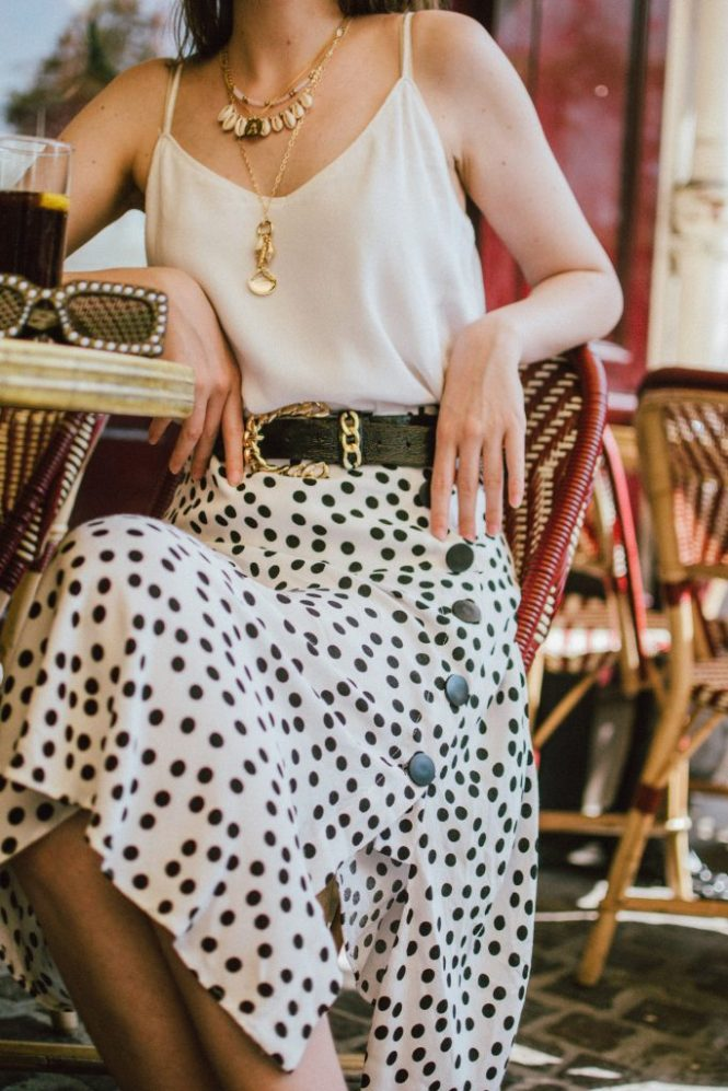 Zara polka dot skirt, white cami top, gucci ace heart sneakers, cherry pom pom straw summer bag, paris, andreea birsan, couturezilla, cute summer outfit ideas 2018, polka dot midi skirt, spaghetti straps white camisole top, mango white, white and black midi skirt, the zara sold out polka dot skirt, basic white cami top, how to wear a midi skirt, what to wear with a midi polka dot skirt, how to style a polka dot skirt, how to wear a polka dot skirt, gucci trainers, gucci ace heart embroidered sneakers, white trainers, heart embroidery, white leather shoes, parisian cafe, skirt and sneakers, shell accessories, shell necklaces, gold layered necklaces, gucci inspired embellished square sunglasses, 90s sunglasses, black sunglasses, printed silk scarf, clear lens aviator glasses, zara glasses, the geeky glasses trend, the clear lens glasses trend you've seen on instagram, popular glasses, gucci 90s inspired square embellished sunglasses with rhinestones, pom pom summer bag, straw bag, asos sold out summer bag, raffia tote bag, statement summer bag, how to look Parisian chic, European summer street style inspiration for women 2017, pinterest chic outfit ideas for woman, summer outfit ideas, summer ootd inspiration, outfit of the day, ootd, fashion icon, style inspiration, fashionista, fashion inspiration, style inspo, what to wear in summer, how to look French, chic on a budget, zara outfit, mango, topshop, asos, river island, forever 21, urban outfitters, how to mix high end pieces with luxury ones, zara and Gucci,outfit alternatives for summer, tomboy chic, minimal outfit, tumblr girls photos, pictures, happy girl, women, smart casual outfits, the best outfit ideas 2017, what to wear when you don't feel inspired, summer in Europe, weekend attire, uniform, French women in summer, European outfit ideas 2017, minimal chic outfit, how to stand out, the best outfit ideas for summer, the sunglasses you have seen everywhere on Instagram, glasses, uk fashion blogger, united kingdom, uk fashion blog, fashion and travel blog, Europe, women with style, street style, summer fashion trends 2017, best fashion ideas, styling, fall fashion, fall outfit, fall ootd, fall perfect, transitional dressing, best transitional outfit ideas, how to wear statement earrings, dressing for autumn, autumn outfit, winter outfit ideas for work and school 2017