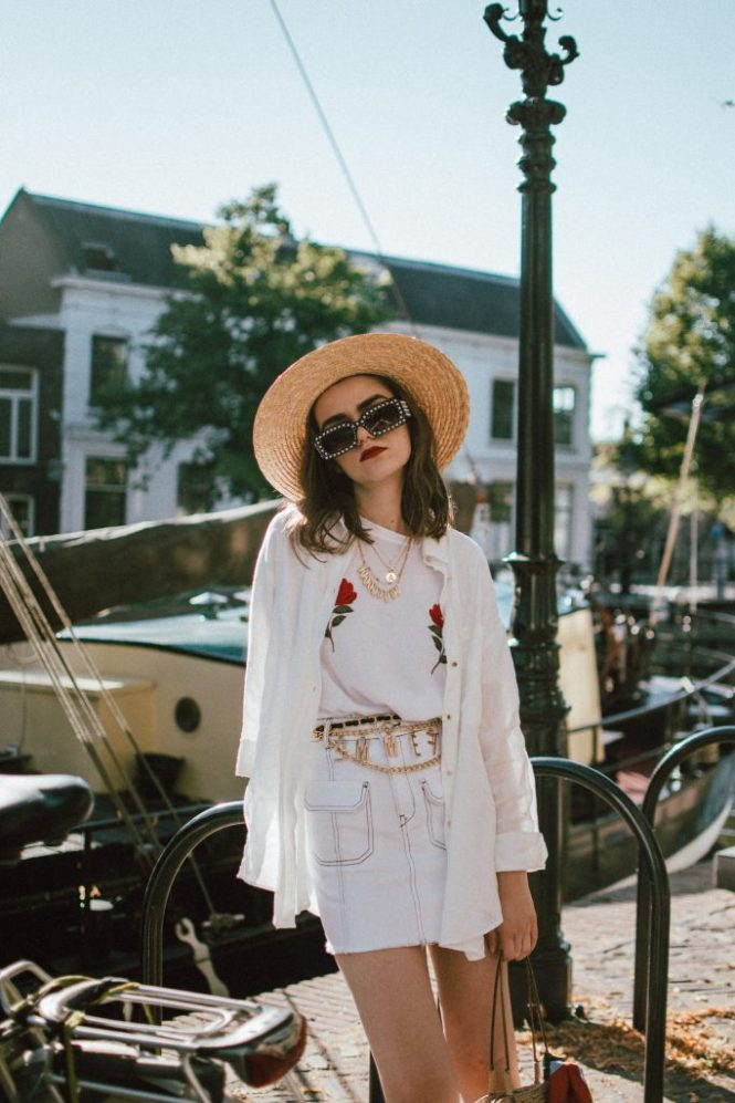 Contrast stitch white denim skirt,  na-kd rose embroidered white  t-shirt, linen shirt, straw bag, andreea birsan, couturezilla, cute summer outfit ideas 2018, zara mini denim skirt, rose shirt, nakd popular soldout rose embroidered tshirt, linen white shirt, boyfriend shirt, button up white shirt, oversized white shirt, how to wear a white shirt in a casual way, contrast stitching trend, the contrast stitch trend you need to try, how to up your basics, all white summer outfit, summer layering, gucci lookalike pearl sunglasses, 90s square sunglasses, statement sunglasses, budget alternative to gucci sunglasses, high street alternative, how to wear a mini skirt without looking vulgar, straw boater hat, straw hat, summer hat, wide brim hat, vintage straw tote bag, netherlands, visit netherlands, holland, schiedam, vintage finds, vintage raffia bag, vintage french bag, stripe silk scarf, tommy hilfiger red espadrilles, red shoes, red summer shoes,  how to look Parisian chic, European summer street style inspiration for women 2017, pinterest chic outfit ideas for woman, summer outfit ideas, summer ootd inspiration, outfit of the day, ootd, fashion icon, style inspiration, fashionista, fashion inspiration, style inspo, what to wear in summer, how to look French, chic on a budget, zara outfit, mango, topshop, asos, river island, forever 21, urban outfitters, how to mix high end pieces with luxury ones, zara and Gucci,outfit alternatives for summer, tomboy chic, minimal outfit, tumblr girls photos, pictures, happy girl, women, smart casual outfits, the best outfit ideas 2017, what to wear when you don't feel inspired, summer in Europe, weekend attire, uniform, French women in summer, European outfit ideas 2017, minimal chic outfit, how to stand out, the best outfit ideas for summer, the sunglasses you have seen everywhere on Instagram, glasses, uk fashion blogger, united kingdom, uk fashion blog, fashion and travel blog, Europe, women with style, street style, summer fashi