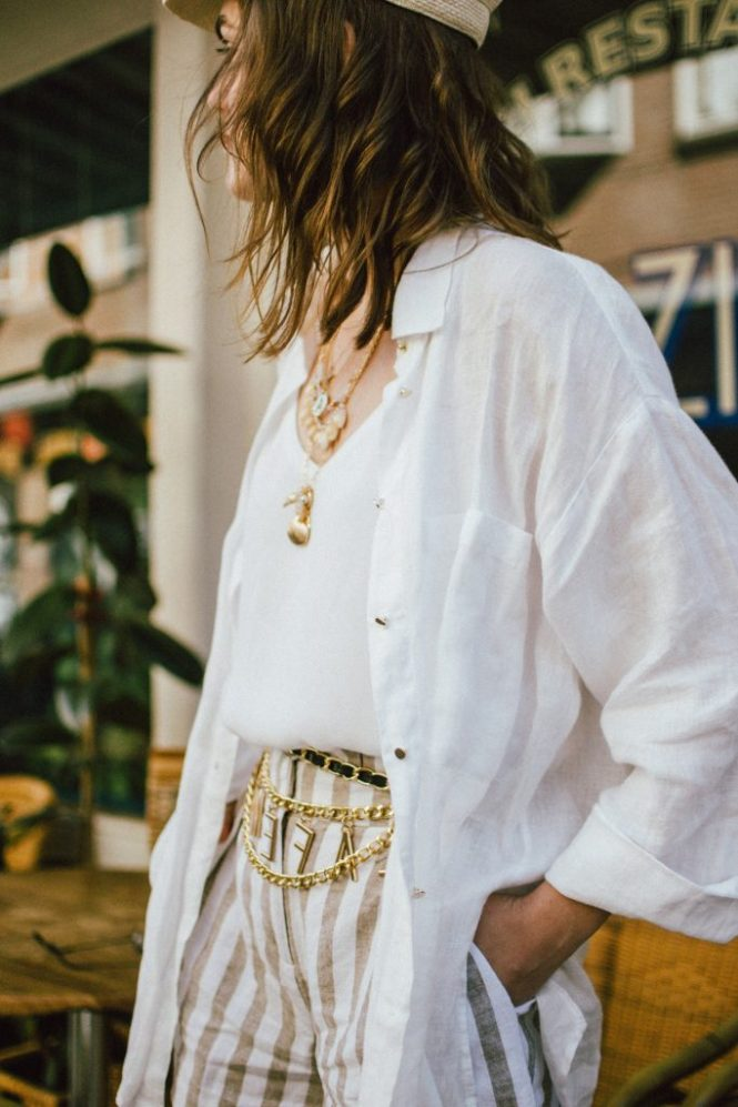 Striped linen shorts, white shirt, cami top, gucci sneakers, straw hat, cult gaia ark bag, cute summer outfit ideas 2018, andreea birsan, couturezilla, stradivarius beige linen shorts with belt, chain belt, la femme chain belt, straw baker boy hat, gucci ace heart embroidered white leather sneakers, white kicks, gucci trainers with hearts, gucci sneakers, the best white sneakers for women, females sneakers, straw newsboy hat, natural straw hat, small oval vintage sunglasses, vintage sunnies, micro sunglasses trend, wavy hair, schiedeam, rotterdam, the netherlands, holland, what to do in schiedam, white cami top, the best cami top, camisole top, blouse, white linen oversized shirt, boyfriend fit white shirt, linen shirt, button up shirt, how to wear shirts in summer, white and beige outfit, what to wear with linen shorts, the best chain belt, chain belt trend, asos, what to wear when traveling, travel outfit, summer travel outfit, how to look Parisian chic, European summer street style inspiration for women 2017, pinterest chic outfit ideas for woman, summer outfit ideas, summer ootd inspiration, outfit of the day, ootd, fashion icon, style inspiration, fashionista, fashion inspiration, style inspo, what to wear in summer, how to look French, chic on a budget, zara outfit, mango, topshop, asos, river island, forever 21, urban outfitters, how to mix high end pieces with luxury ones, zara and Gucci,outfit alternatives for summer, tomboy chic, minimal outfit, tumblr girls photos, pictures, happy girl, women, smart casual outfits, the best outfit ideas 2017, what to wear when you don't feel inspired, summer in Europe, weekend attire, uniform, French women in summer, European outfit ideas 2017, minimal chic outfit, how to stand out, the best outfit ideas for summer, the sunglasses you have seen everywhere on Instagram, glasses, uk fashion blogger, united kingdom, uk fashion blog, fashion and travel blog, Europe, women with style, street style, summer fashion trends 2017, best fashion ideas, styling, fall fashion, fall outfit, fall ootd, fall perfect, transitional dressing, best transitional outfit ideas, how to wear statement earrings, dressing for autumn, autumn outfit, winter outfit ideas for work and school 2017, layered necklaces, shell necklace, seastar necklace, gold layered necklaces, summer necklaces, coin necklace, initial necklace