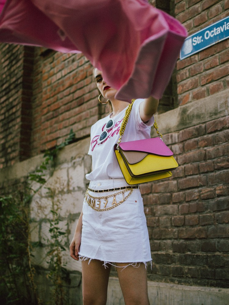 Pink blazer, white denim skirt, white tee, gucci sneakers, colorblock shoulder bag, andreea birsan, couturezilla, cute fall outfit ideas 2018, la femme gold chain belt, the chain belt trend, white cat eye sunglasses, cat eye sunnies, autumn outfit ideas, transitional outfits, pre-fall white and pink outfit 2018, what color to wear with pink, pink and white looks, how to transition your wardrobe to autumn, white mini raw hem denim skirt, deconstructed mini skirt, crisp white mango premium white denim skirt, what to wear with a mini skirt, what are the best shoes to wear with a mini skirt, gucci white and red sneakers, gucci white leather trainers, white gucci kicks, the ugly dad sneakers trend, gucci dad sneakers, bowling shoes trend, chunky trainers trend, chunky sneakers trend, white sunnies, heart breaker white t-shirt, white skirt and t-shirt, organic cotton tee, embroidered t-shirt, mini skirt, how to wear a mini skirt without looking vulgar, gucci shoes, isla fontaine pink and yellow leather bag, italian leather shoulder bag, italian bag, gold hoop earrings, hoop earrings, white and pink pre-fall 2018 outfit ideas for women, how to look Parisian chic, European summer street style inspiration for women 2017, pinterest chic outfit ideas for woman, summer outfit ideas, summer ootd inspiration, outfit of the day, ootd, fashion icon, style inspiration, fashionista, fashion inspiration, style inspo, what to wear in summer, how to look French, chic on a budget, zara outfit, mango, topshop, asos, river island, forever 21, urban outfitters, how to mix high end pieces with luxury ones, zara and Gucci,outfit alternatives for summer, tomboy chic, minimal outfit, tumblr girls photos, pictures, happy girl, women, smart casual outfits, the best outfit ideas 2017, what to wear when you don't feel inspired, summer in Europe, weekend attire, uniform, French women in summer, European outfit ideas 2017, minimal chic outfit, how to stand out, the best outfit ideas for summer, the sunglasses you have seen everywhere on Instagram, glasses, uk fashion blogger, united kingdom, uk fashion blog, fashion and travel blog, Europe, women with style, street style, summer fashion trends 2017, best fashion ideas, styling, fall fashion, fall outfit, fall ootd, fall perfect, transitional dressing, best transitional outfit ideas, how to wear statement earrings, dressing for autumn, autumn outfit, winter outfit ideas for work and school 2017, double breasted pastel pink blazer