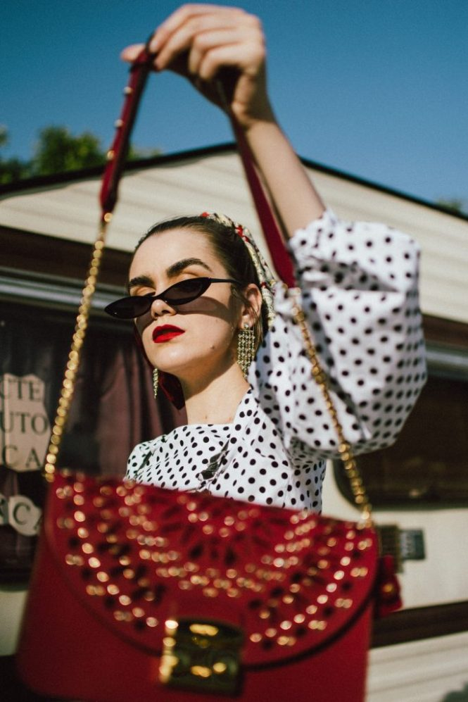 Polka dot denim dungaree, balloon sleeve top, white heels, red furla bag, andreea birsan, couturezilla, cute fall outfit ideas 2018fashion, fall outfit, fall ootd, fall perfect, transitional dressing, best transitional outfit ideas, how to wear statement earrings, dressing for autumn, autumn outfit, winter outfit ideas for work and school 2017, black and white polka dot denim dungarees, denim overall, how to look chic in denim dungarees, polka dot jumpsuit, polka dot overall for fall 2018, how to layer a jumpsuit, what to wear with a denim overall, how to avoic looking like a kid in dungarees, how to pattern clash, how to mix two polka dot pieces, what to wear with polka dots, how to make polka dots look chic, black white and red outfit, what shoes to wear with wide leg dungarees, wide leg polka dot denim dungarees, culotte dungarees, zara cotton white polka dot lantern sleeve blouse, polka dot balloon sleeve top, polka dot shirt, chic polka dot top, statement earrings, rhinestone earrings, teardrop rhinestone earrings, asos small cat eye sunglasses, micro sunglasses trend, mini sunglasses, small sunglasses, small cat eye sunnies, burgundy scarf, how to style a silk scarf in your hair, hair scarf, pony tail with scarf, white leather pumps, white block heel leather pumps, white square heel pumps, ruby red lace insertion furla metropolis shoulder bag, red furla metropolis, insertion furla metropolis bag, chain belt, la femme chain belt, sold out chain belt, how to style denim dungarees in fall, autumn outfit ideas 2018, how to look Parisian chic, European summer street style inspiration for women 2017, pinterest chic outfit ideas for woman, summer outfit ideas, summer ootd inspiration, outfit of the day, ootd, fashion icon, style inspiration, fashionista, fashion inspiration, style inspo, what to wear in summer, how to look French, chic on a budget, zara outfit, mango, topshop, asos, river island, forever 21, urban outfitters, how to mix high end pieces with luxury on