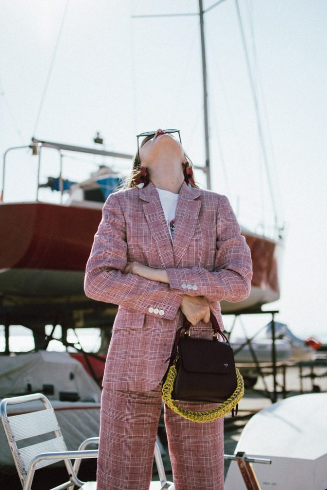 Massimo Dutti suit, graphic t-shirt, gucci inspired mules, graphic tees, lady bag, andreea birsan in izmir turkey, couturezilla, cute fall outfit ideas 2018, plaid linen suit, dressed in dutti, blush pink plaid suit, what shoes to wear with a women's suit, pointy cat eye sunglasses, tips on how to style a suit for women, the suit you need to wear this autumn, check printed blush pink double breasted blazer, blazers for women, the blazer you will wear on repeat this fall, how to style straight leg trousers, blush pink check printed linen trousers, how to wear linen in fall, check printed suit and gucci inspired fur mules, black mules with fur, the high street alternative to the popular gucci mules, gucci dupe mules, black loafers, gucci dupe loafers, isla fontaine dark red lady bag, italian leather bag, genuine leather bag, burgundy bag and pink suit, graphic t-shirt and suit, printed t-shirt, guns and roses t-shirt, white tee, graphic t-shirt, printed, pink plaid suit, where to get a pink plaid suit, gucci inspired black loafers with lion embroidery and fur, gucci princeton inspired, classic shoes, timeless shoes and pink plaid suit, pink plaid suit and guns and roses t-shirt, rock band t-shirt, rock tee, zara big flower earrings, moschino pointy cat eye sunglasses, cat eye sunnies, embellished sunglasses, where to find the best cat eye sunglasses, what to wear in turkey in autumn, how to look Parisian chic, European summer street style inspiration for women 2017, pinterest chic outfit ideas for woman, summer outfit ideas, summer ootd inspiration, outfit of the day, ootd, fashion icon, style inspiration, fashionista, fashion inspiration, style inspo, what to wear in summer, how to look French, chic on a budget, zara outfit, mango, topshop, asos, river island, forever 21, urban outfitters, how to mix high end pieces with luxury ones, zara and Gucci,outfit alternatives for summer, tomboy chic, minimal outfit, tumblr girls photos, pictures, happy girl, women, smart casual outfits, the best outfit ideas 2017, what to wear when you don't feel inspired, summer in Europe, weekend attire, uniform, French women in summer, European outfit ideas 2017, minimal chic outfit, how to stand out, the best outfit ideas for summer, the sunglasses you have seen everywhere on Instagram, glasses, uk fashion blogger, united kingdom, uk fashion blog, fashion and travel blog, Europe, women with style, street style, summer fashion trends 2017, best fashion ideas, styling, fall fashion, fall outfit, fall ootd, fall perfect, transitional dressing, best transitional outfit ideas, how to wear statement earrings, dressing for autumn, autumn outfit, winter outfit ideas for work and school