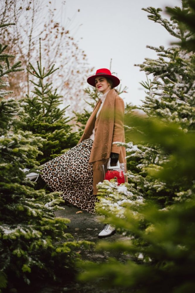 Camel coat, leopard print midi skirt, white combat boots, red chloe drew bag, andreea birsan, couturezilla, cute winter street style outfit ideas 2018, what to wear when you're running last minute holiday errands, italian hand made camel coat, wool camel coat, where to find the best camel coat, good quality camel coat for women, how to wear leopard print in winter, christmas trees at farmers market, cashmere turtleneck sweater, red accessories, all beige and brown outfit with pops of red for winter and christmas, how to wear leopard prints for christmas winter, red wool fedora hat, swiss red fedora hat for women, white leather topshop combat boots, white military boots for women, how to wear bulky boots with skirts, ankle length pleated leopard print skirt, beige cashmere sweater from h&m, how to layer and stay warm in winter, red stockings, red pantyhose, red tights, why you should wear colorful tights, mango transparent tote bag, staud inspired transparent bag, andreea birsan couturezilla cute winter outfit ideas 2018, the only camel coat you need, red chloe drew dupe bag, red shoulder bag, bag in bag trend, pvc bag, how to look Parisian chic, European summer street style inspiration for women 2017, pinterest chic outfit ideas for woman, summer outfit ideas, summer ootd inspiration, outfit of the day, ootd, fashion icon, style inspiration, fashionista, fashion inspiration, style inspo, what to wear in summer, how to look French, chic on a budget, zara outfit, mango, topshop, asos, river island, forever 21, urban outfitters, how to mix high end pieces with luxury ones, zara and Gucci,outfit alternatives for summer, tomboy chic, minimal outfit, tumblr girls photos, pictures, happy girl, women, smart casual outfits, the best outfit ideas 2017, what to wear when you don't feel inspired, summer in Europe, weekend attire, uniform, French women in summer, European outfit ideas 2017, minimal chic outfit, how to stand out, the best outfit ideas for summer, the sunglasses you have seen everywhere on Instagram, glasses, uk fashion blogger, united kingdom, uk fashion blog, fashion and travel blog, Europe, women with style, street style, summer fashion trends 2017, best fashion ideas, styling, fall fashion, fall outfit, fall ootd, fall perfect, transitional dressing, best transitional outfit ideas, how to wear statement earrings, dressing for autumn, autumn outfit, winter outfit ideas for work and school, chanel leather gloves, gold hoop earrings