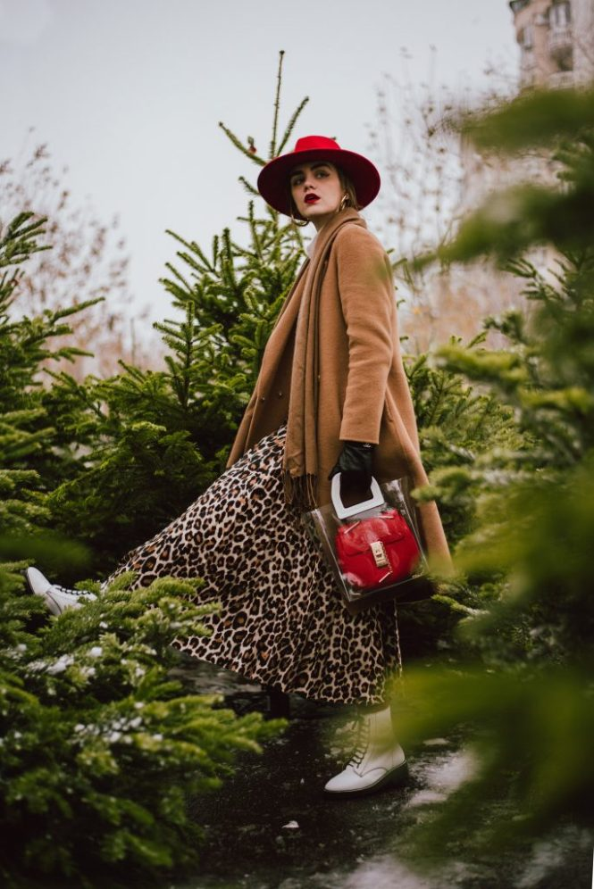 Camel coat, leopard print midi skirt, white combat boots, red chloe drew bag, andreea birsan, couturezilla, cute winter street style outfit ideas 2018, what to wear when you're running last minute holiday errands, italian hand made camel coat, wool camel coat, where to find the best camel coat, good quality camel coat for women, how to wear leopard print in winter, christmas trees at farmers market, cashmere turtleneck sweater, red accessories, all beige and brown outfit with pops of red for winter and christmas, how to wear leopard prints for christmas winter, red wool fedora hat, swiss red fedora hat for women, white leather topshop combat boots, white military boots for women, how to wear bulky boots with skirts, ankle length pleated leopard print skirt, beige cashmere sweater from h&m, how to layer and stay warm in winter, red stockings, red pantyhose, red tights, why you should wear colorful tights, mango transparent tote bag, staud inspired transparent bag, andreea birsan couturezilla cute winter outfit ideas 2018, the only camel coat you need, red chloe drew dupe bag, red shoulder bag, bag in bag trend, pvc bag, how to look Parisian chic, European summer street style inspiration for women 2017, pinterest chic outfit ideas for woman, summer outfit ideas, summer ootd inspiration, outfit of the day, ootd, fashion icon, style inspiration, fashionista, fashion inspiration, style inspo, what to wear in summer, how to look French, chic on a budget, zara outfit, mango, topshop, asos, river island, forever 21, urban outfitters, how to mix high end pieces with luxury ones, zara and Gucci,outfit alternatives for summer, tomboy chic, minimal outfit, tumblr girls photos, pictures, happy girl, women, smart casual outfits, the best outfit ideas 2017, what to wear when you don't feel inspired, summer in Europe, weekend attire, uniform, French women in summer, European outfit ideas 2017, minimal chic outfit, how to stand out, the best outfit ideas for summer, the sunglasses y