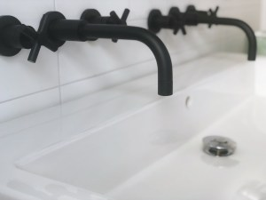 double trough vessel sink with wall mounted faucets
