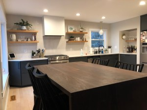 modern kitchen with open shelving and walnut table