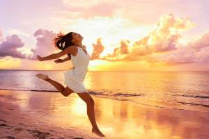Woman runing on a sun-drenched beach