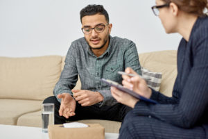 A recovering addict talking with an experienced, credible rehab therapist.