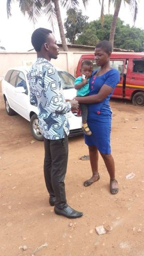 CMM Outreach leader Matthew Kenu witnessing to a lady with her baby