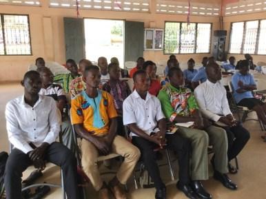 Students listening to Pastor Harrison