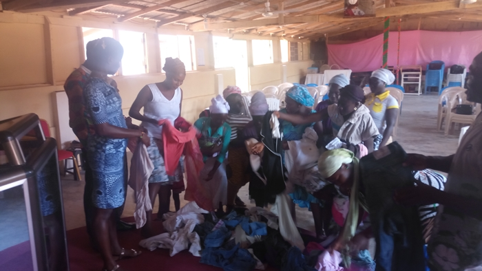 Women going through the donated clothing3