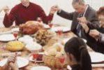 Family Celebrates Thanksgiving Pray Praise God