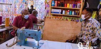 John Dramani Mahama interacting with Joshua Setordzi