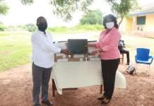 Ms. Evelyn Araba Zentey (District Director) receiving the laptops from Hon. Wisdom Kobena Mensah Woyome (MP)