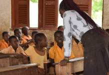 A Ghanaian teacher teaching pupils
