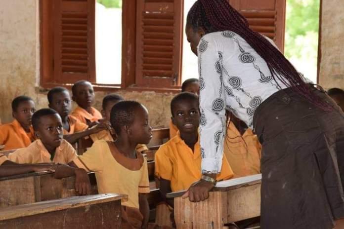 A Ghanaian teacher teaching pupils