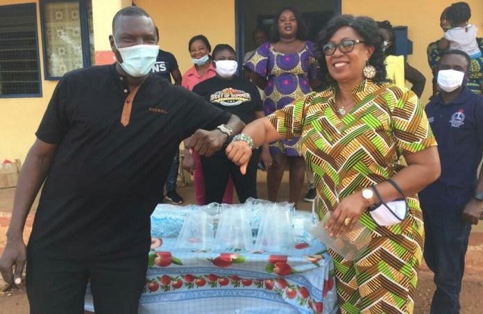 Maxwell Kwame Lukutor presenting PPEs to Evelyn Araba Zentey