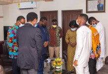 Chairman of the Church of Pentecost, Apostle Eric Nyamekye praying with 2020 National Science and Maths Quiz (NSMQ) winners