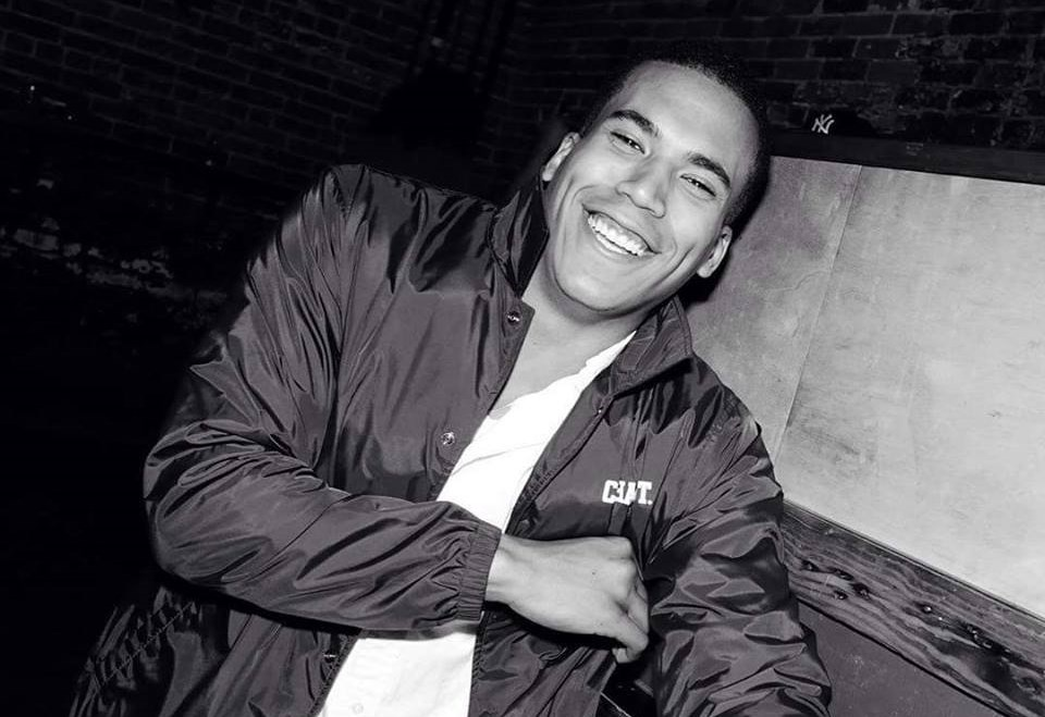 Tarreece Sampson smiling in a black-and-white photo