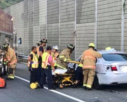Crash car with paramedics and firefighters working