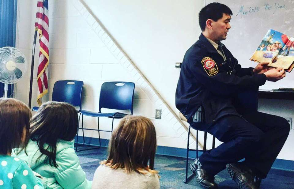 Officer reading to kids