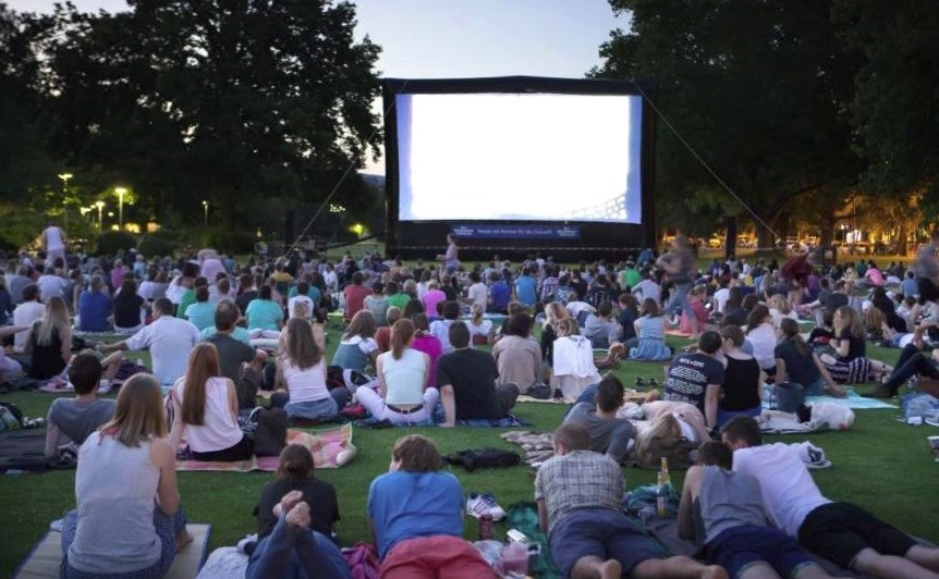 People watching movie on lawn