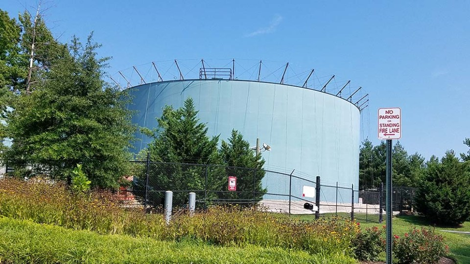 exterior shot of water tank with scaffolding visible