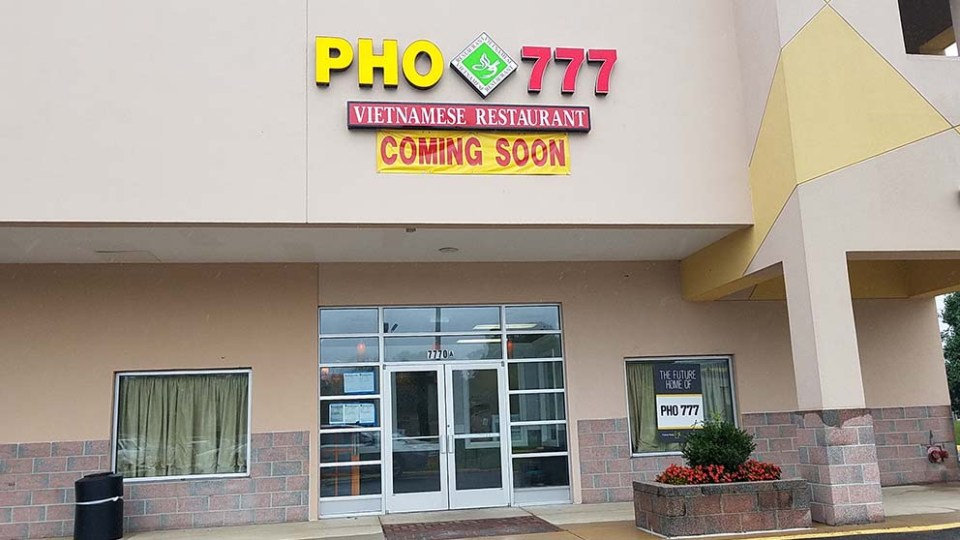 "Pho 777 storefront with ""coming soon"" sign"
