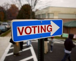 Sign that says Voting with arrow
