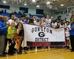Players holding Gunston District banner