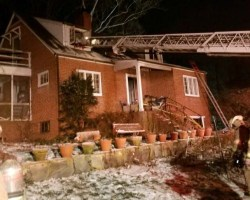 Ladder from truck going to house
