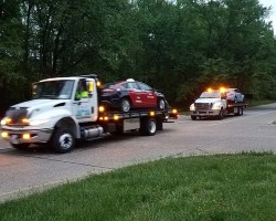 Cars being towed from scene