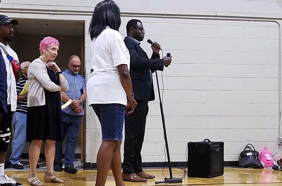 Annan speaking at microphone