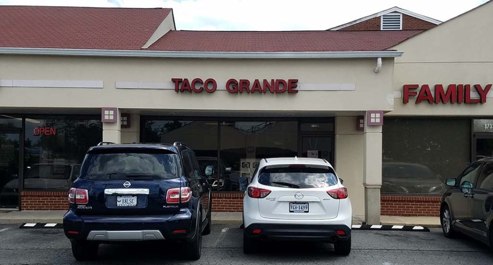 Storefront with old Taco Grande sign still up.