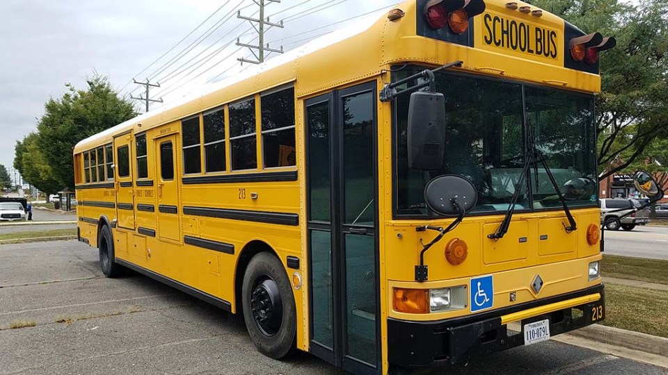 FCPS school bus parked at the Old Mount Vernon High School on Richmond Highway