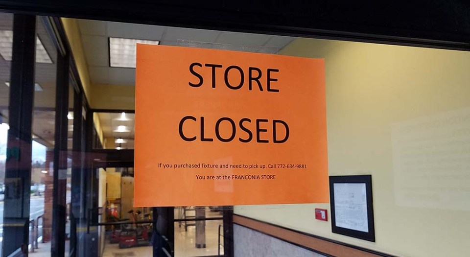 """""""Store Closed"""" sign on door to Shoppers"""