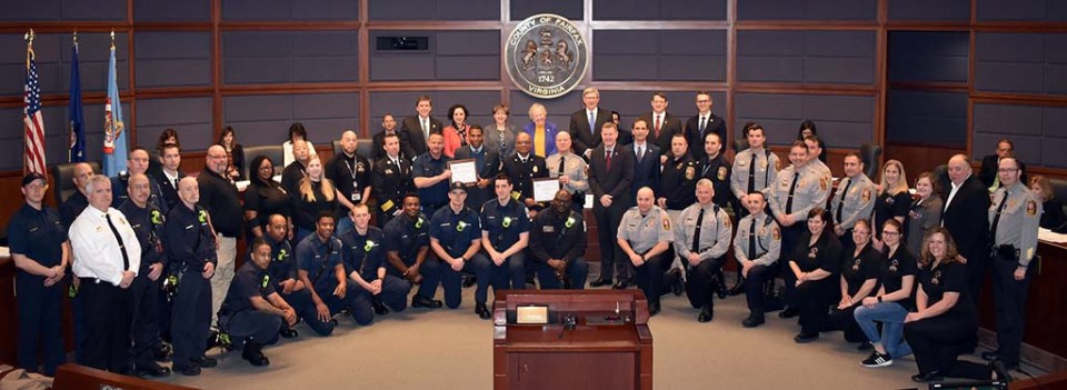 wide framed image of firefighters, police and others who helped with South Alex fire