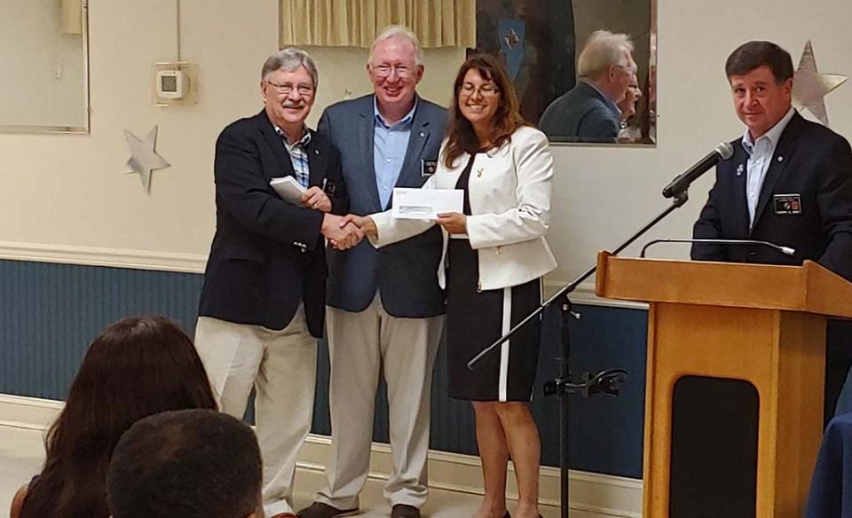 Spychaj and Hayden presenting award