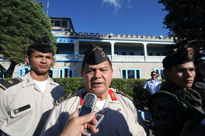 Honduran Chief of Joint Staff, Romeo Vasquez Velasquez (C), speaks to the press after overseeing the exit of ousted Honduran President Manuel Zelaya aboard the aircraft of Dominican President Leonel Fernandez in Tegucigalpa January 27, 2010. Zelaya and his family left Honduras Wednesday bound for the Dominican Republic after more than four months holed up in Brazil's embassy. The jet took off at 2135 GMT from the Tontontin airport amid hopes that the swearing-in of newly elected President Porfirio Lobo earlier in the day could end the turmoil triggered by Zelaya's June overthrow. AFP PHOTO/STR (Photo credit should read STR/AFP/Getty Images)