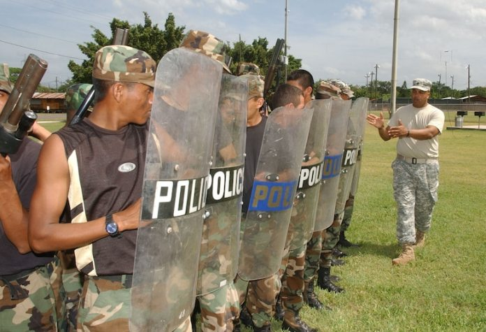 SOTO CANO AIR BASE, Honduras -- Army Staff Sgt. Pablo Canales, U.S. Army South Provost Marshall's Office, lines up students during a Honduran Military Police training class July 12, 2007. (U.S. Air Force Photo/Martin Chahin)